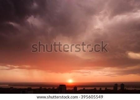 Fiery sunset after rain in Samara - stock photo