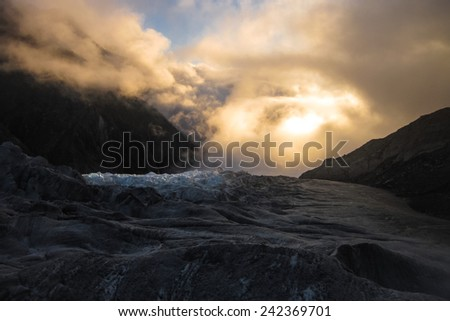 Fiery Sunset over the Fox Glacier, South Island of New Zealand - stock photo