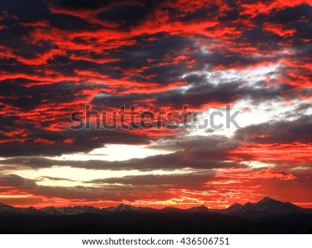 Fiery sunset over the rocky mountains as seen from Broomfield, colorado - stock photo