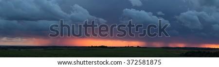fiery sunset sky storm panorama - stock photo