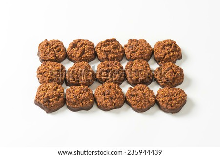 fifteen chocolate chip cookies dipped in melted chocolate - stock photo