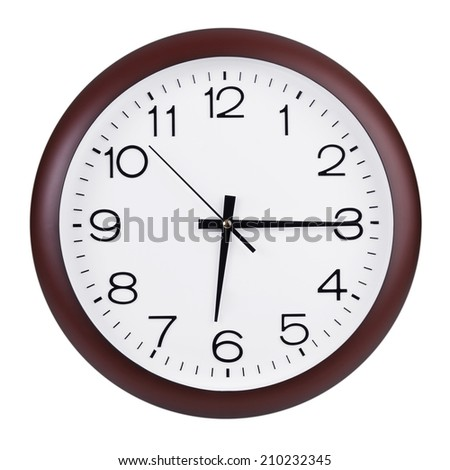 Fifteen minutes of the seventh on the round big dial - stock photo