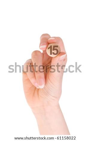 Fifteenth bingo ball in the hand - stock photo