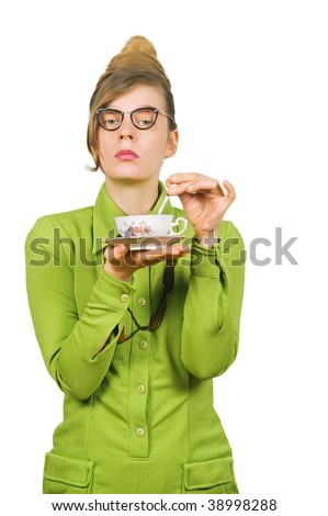 Fifties style young dismissive woman with her tea - stock photo