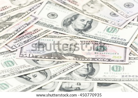 Fifty and hundred dollars banknotes as background - stock photo