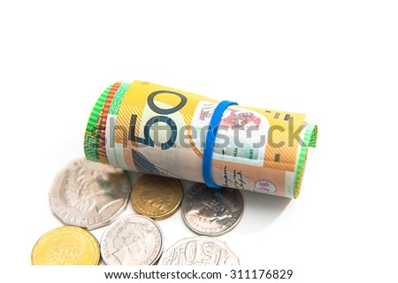 Fifty Australian Dollars roll and some coins with isolate on white background - stock photo