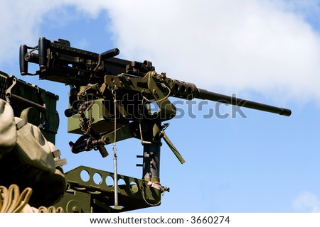 fifty-cal machine gun standing at the ready position for combat - stock photo
