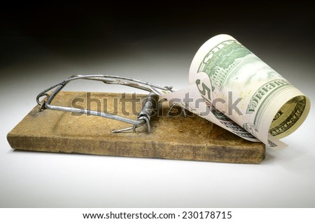 Fifty dollar banknote in mouse trap - stock photo