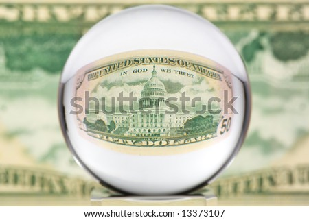 Fifty dollar banknote through glass sphere. Blur background. - stock photo
