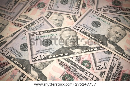 Fifty dollar banknotes stacks close-up (depth of field) - stock photo