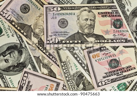 Fifty dollar bills money pile. - stock photo
