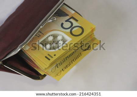 Fifty Dollar Notes in a Purse - stock photo