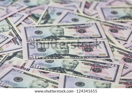 Fifty dollars background. Shallow depth of field - stock photo