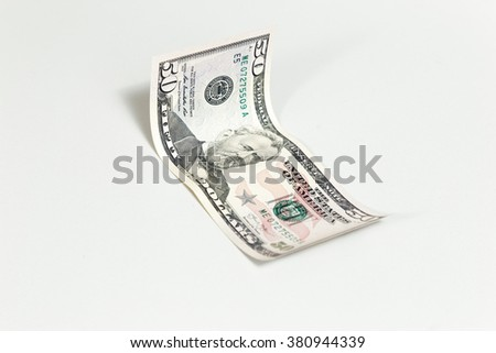 Fifty dollars banknotes on white background