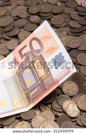 Fifty euro banknote and coins  - stock photo
