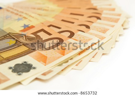 fifty euro banknotes on background of money