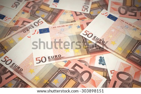 Fifty Euro banknotes stacks (depth of field) - stock photo