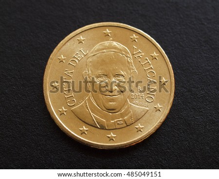 Fifty Euro cent coin from Vatican City bearing the portrait of Pope Bergoglio Francis I isolated over black background