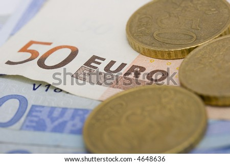 fifty euro note and euros coins close up