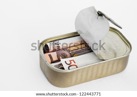 Fifty euro notes stuffed in a can - stock photo
