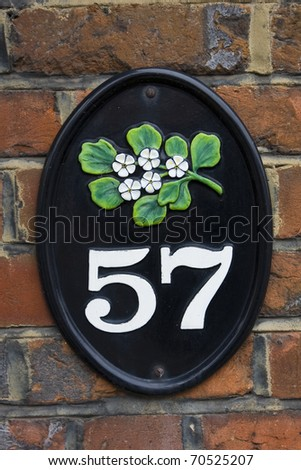 Fifty seven  house number - stock photo
