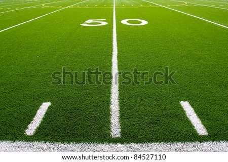Fifty Yard Line of a Football Field with hashmarks in the foreground - stock photo