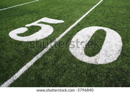 Fifty yard line on a pristine American Football field. - stock photo