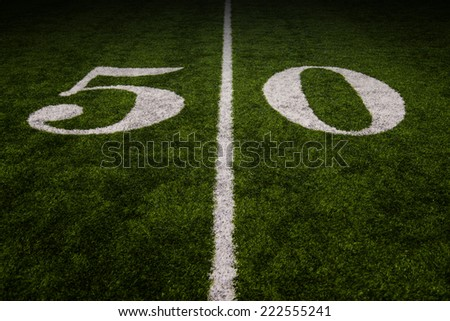 fifty-yard line on an american football field - stock photo