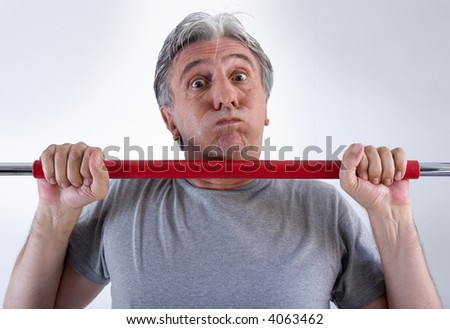 Fifty-year-old man training with difficulty - stock photo
