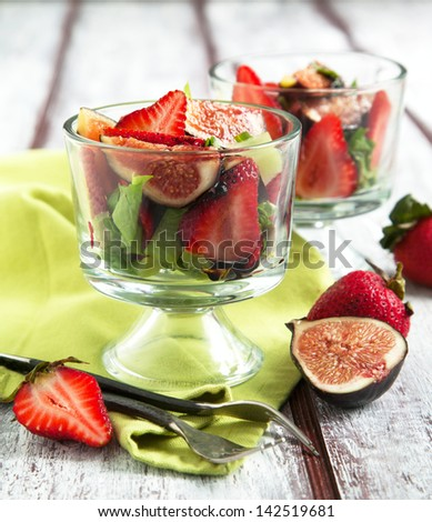 Fig and strawberry salad with balsamic glaze - stock photo