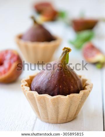 Fig fruit cup cake on a light wooden boards. Selective focus - stock photo