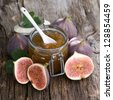 Fig jam in a preserving glass - stock