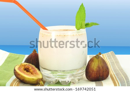 fig milkshake and fruit in sky blue background