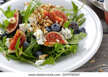 fig salad with soft cheese and blueberries, food closeup