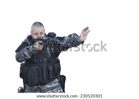 Fight against terrorism, Special Forces soldier, with assault rifle, police swat, gives a stop command, isolated on white - stock photo