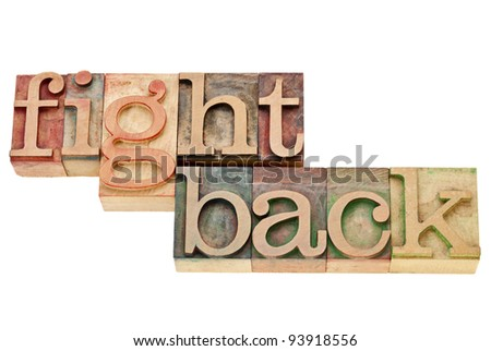 fight back - motivation concept - isolated words in vintage wood letterpress printing blocks - stock photo