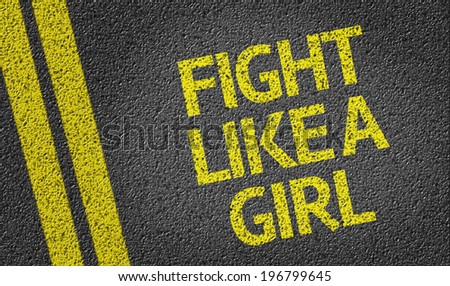 Fight Like a Girl written on the road - stock photo