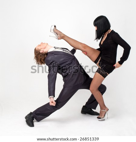 Fight. Young couple on a gray background. - stock photo