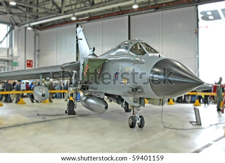 Fighter aircraft in a hanger - stock photo