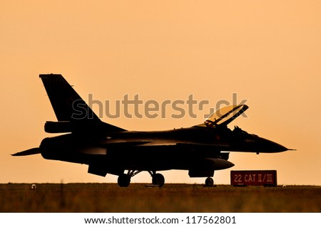 Fighter aircraft sunset - stock photo