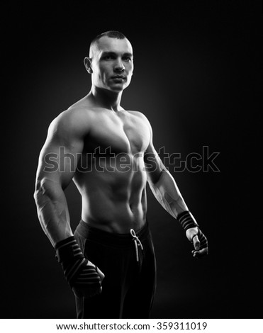 Fighter boxer on black background - stock photo