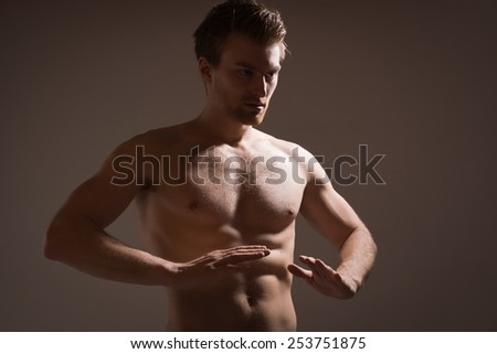 Fighter doing warm up stretch - stock photo