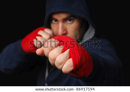 Fighter in training moment (focus on the first hand) - stock photo