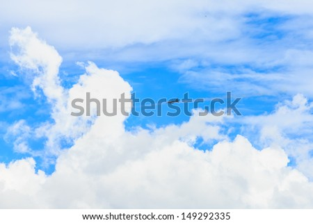 fighter jet launching missile to the target against white cloud and blue sky - stock photo