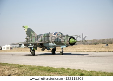 Fighter jet prepares to take off - stock photo