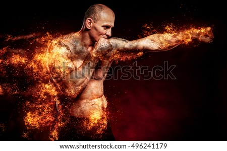 Fighter man in fire. Sport advertising. MMA boxer.