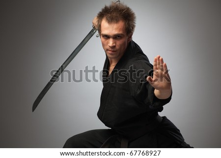 Fighter ninja with sword - stock photo