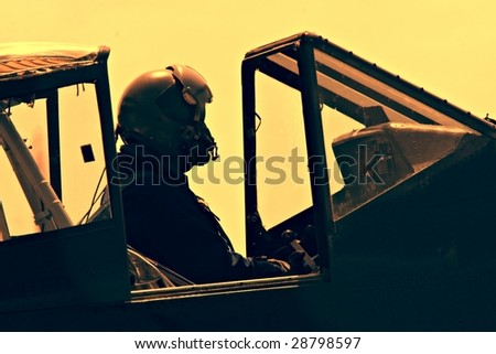 Fighter Pilot in old plane - stock photo