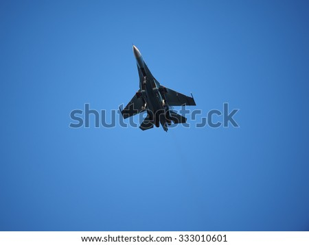 Fighter plane in the sky - stock photo