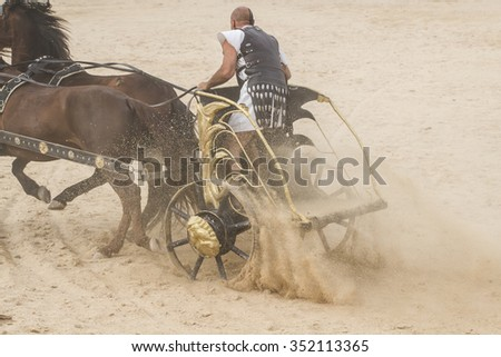 Fighter, Roman chariot in a fight of gladiators, bloody circus - stock photo